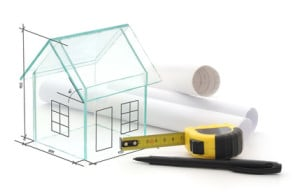 a stylised drawing of a house and a tape measure which could be used when planning renovation an older house