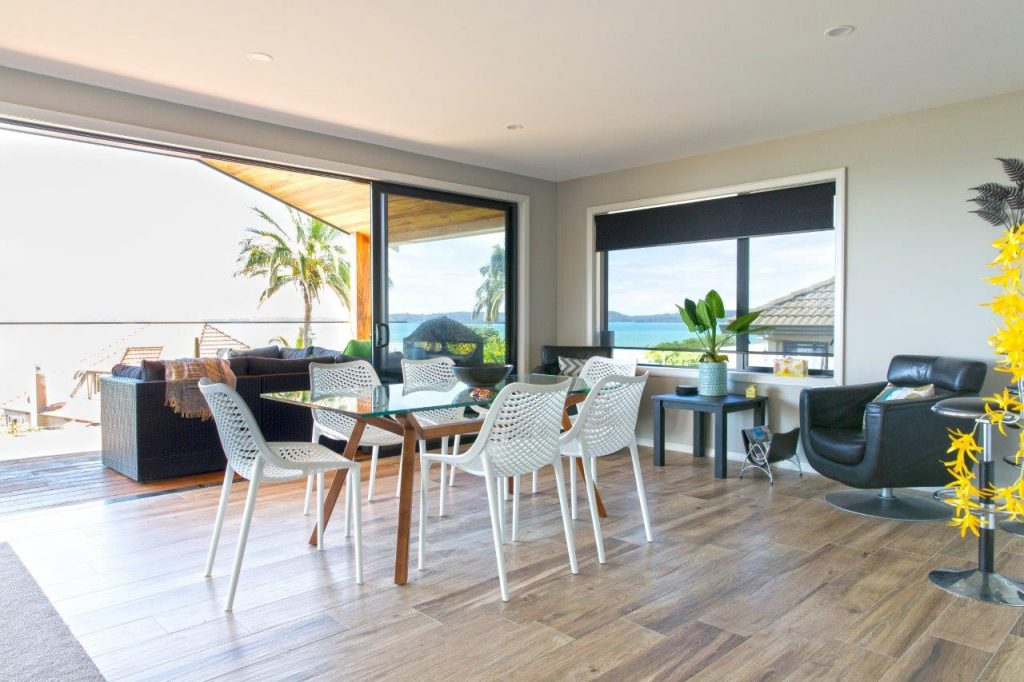 Dining table and chairs with view of ocean