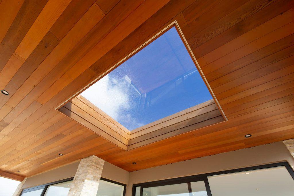 Showing cedar paneling around skylight