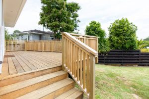 wooden deck and steps with wooden fencing