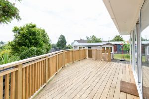 wooden deck with wooden fence along the edge