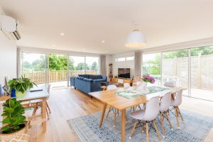 Open plan dining room and living room with dining table and sofas