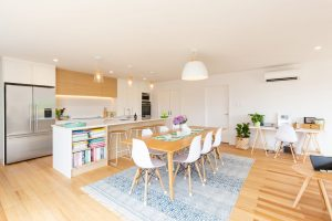 renovated dining room with wooden flooring