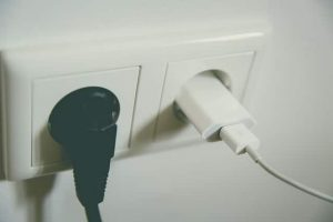 a normal plug wall socket next to a usb socket showing how future proofing your home could include different power options
