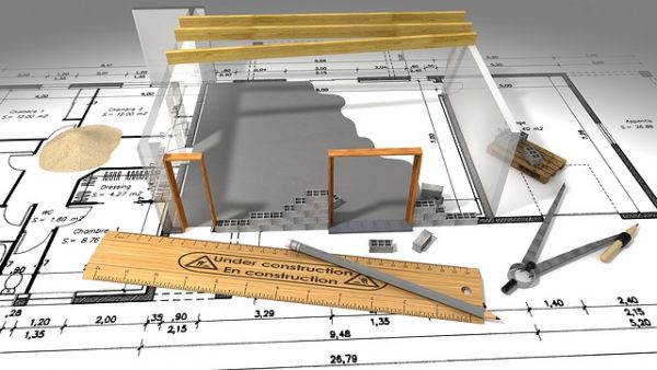 plans and drawing equipment showing house plans which is one of the benefits of building a new home