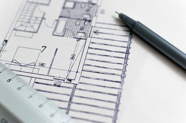 pen, ruler and plan for building a small home
